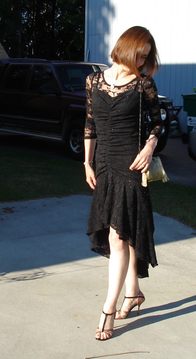 midlife woman looking posh chic in a cocktail dress