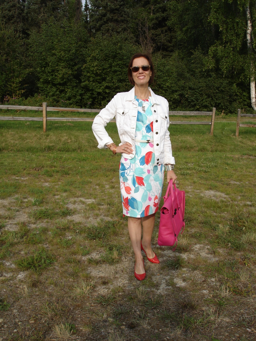 #over40fashion mature woman in a white denim jacket over sheath dress
