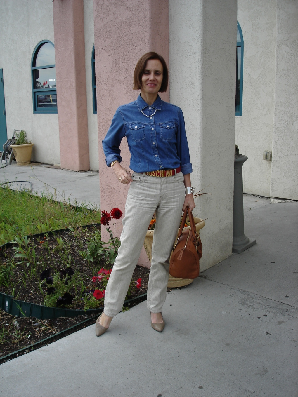 over40fashion mature woman wearing a tailored denim shirt with linen pants for Casual Friday
