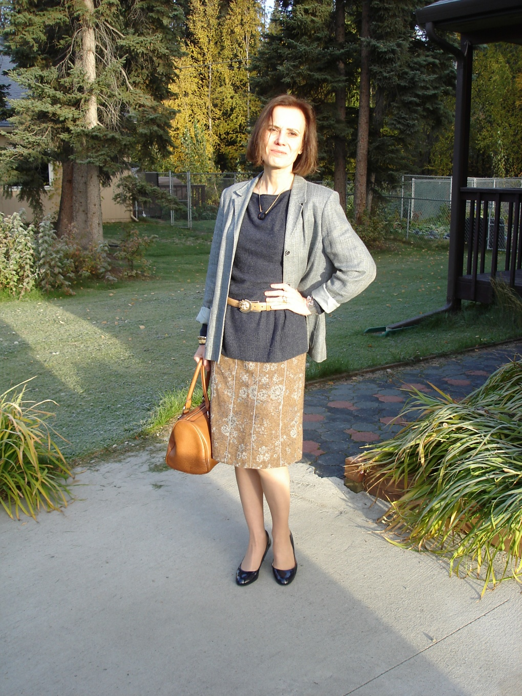 midlife fashion mature woman in tweed skirt with blazer as unmatched suit for work