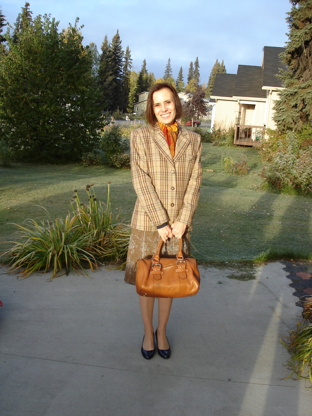 style over 50 mature woman wearing a tweed skirt styled with outerwear