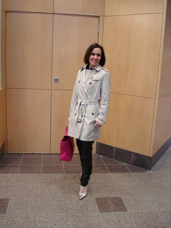 #fashionover50 mature woman in Burberry trench coat and leather pants