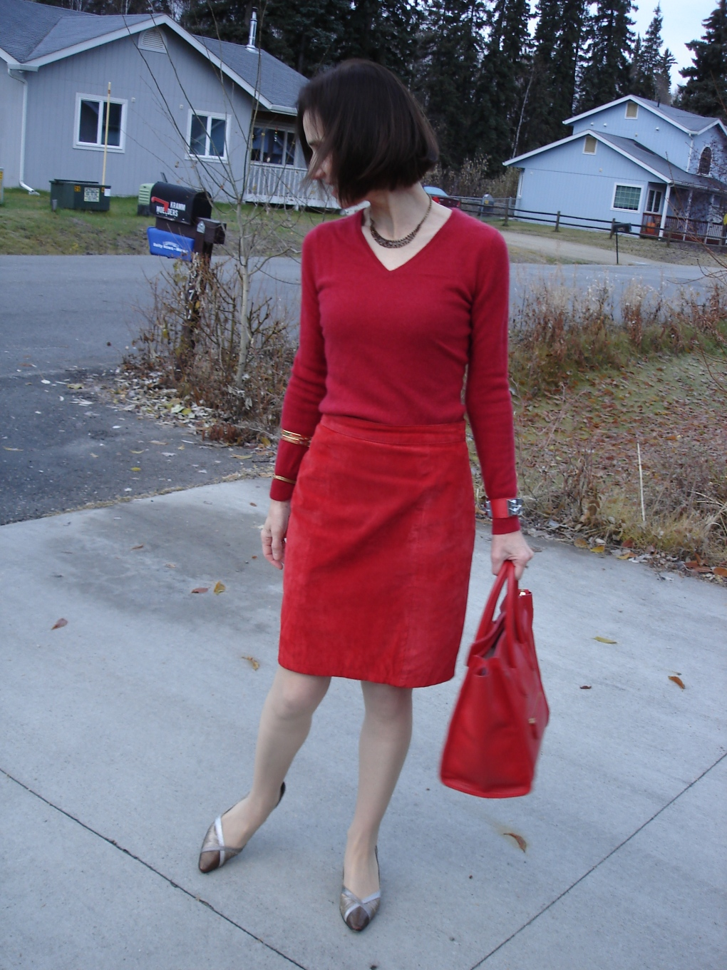 #suedeover40 mature woman in suede straight skirt