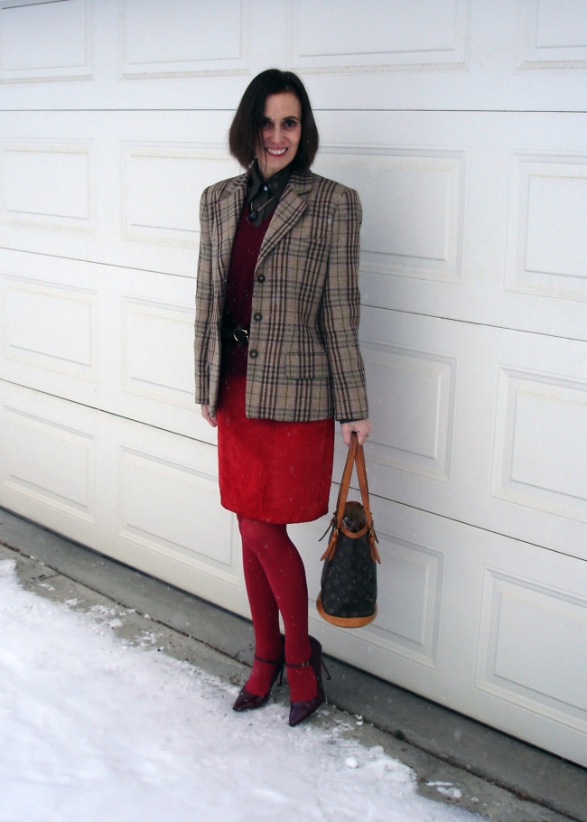 Fashion over 50 woman in plaid blazer and red suede skirt