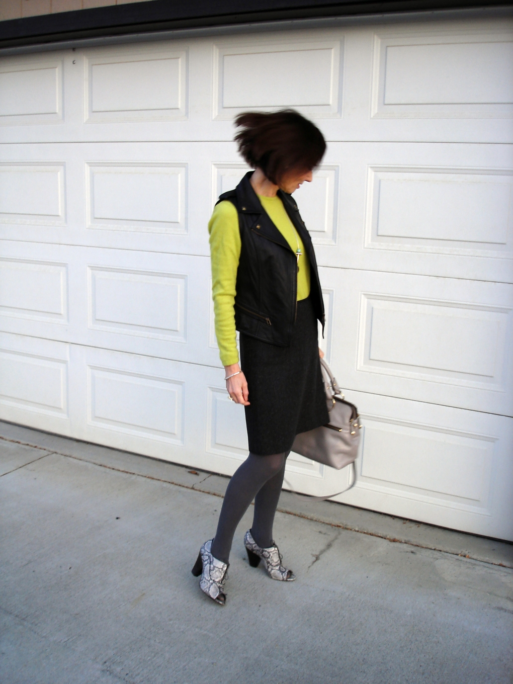 #maturestyle woman in tweed skirt with motorcycle vest