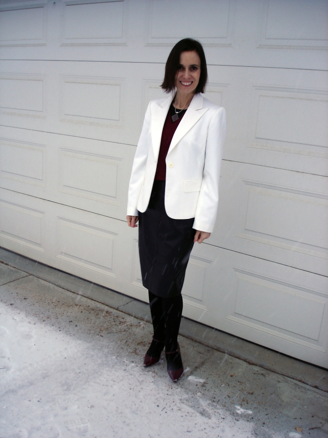 #fashionover50 Mature modern office outfit with white blazer and black leather skirt