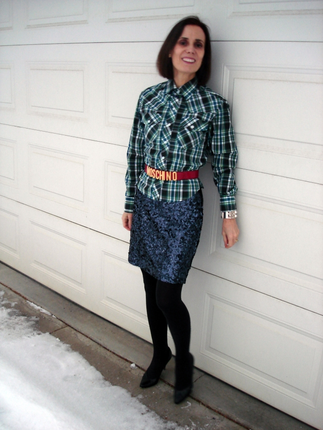styleover50 woman wearing a sequin skirt with plaid for an eclectic look