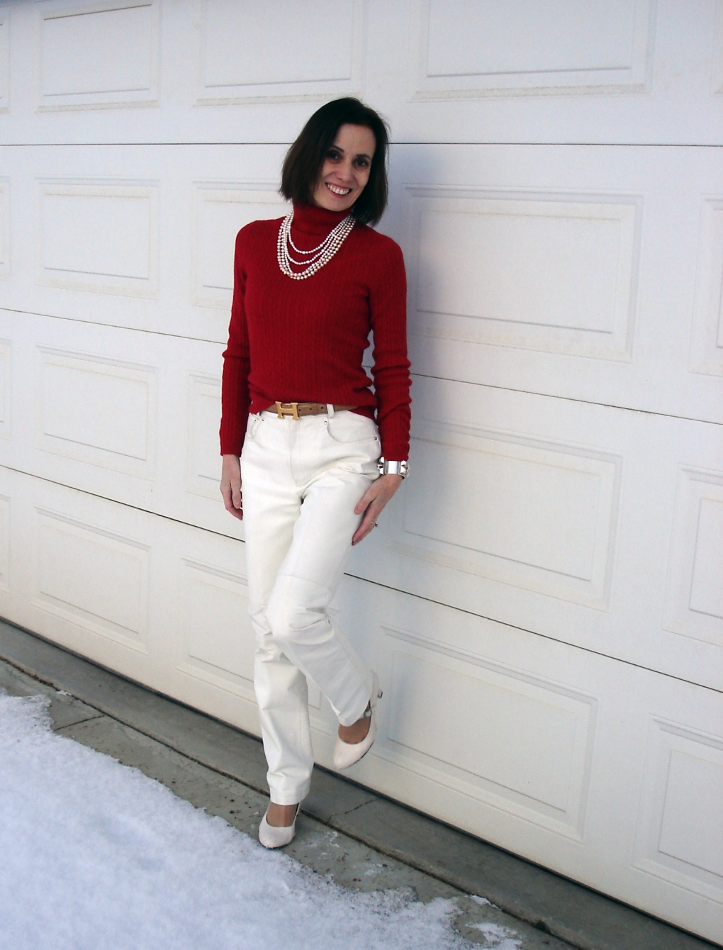 40plusfashion woman in cable knit turtleneck sweater with pants