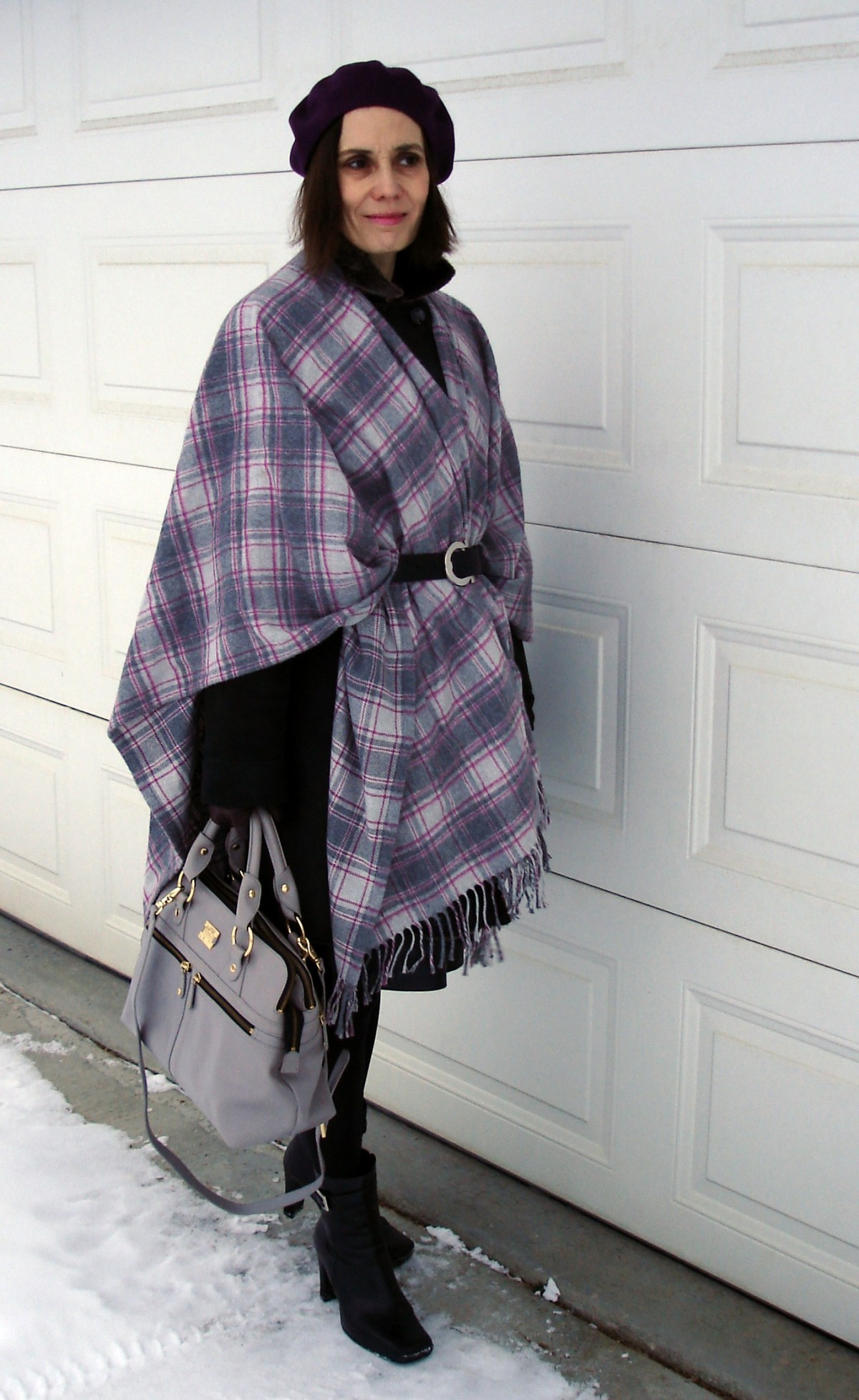 #streetstyle #over-40-fashion http://www.highlatitudestyle.com Mature woman wearing a poncho over a coat