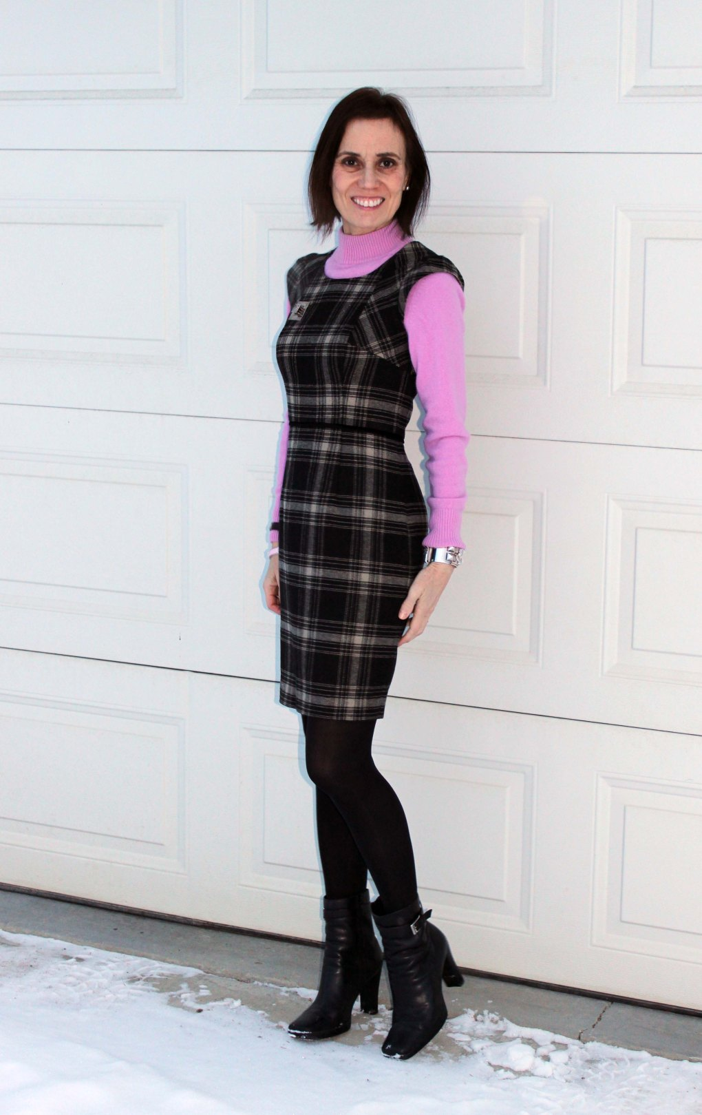 fashion over 40woman in mockneck cashmere sweater under a sheath dress