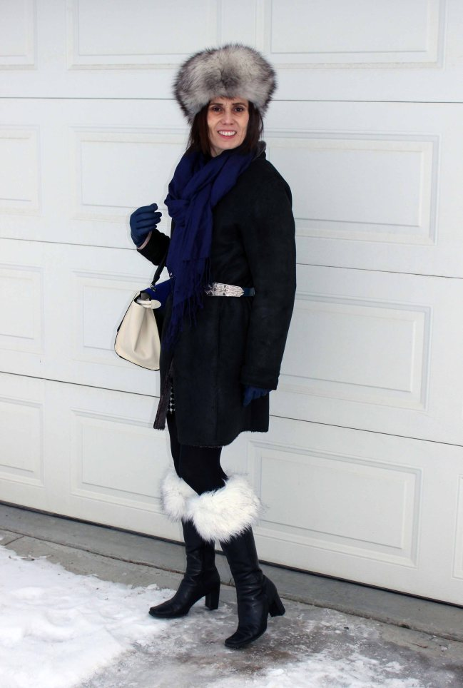 #maturestyle woman wearing a shearling coat and boot toppers