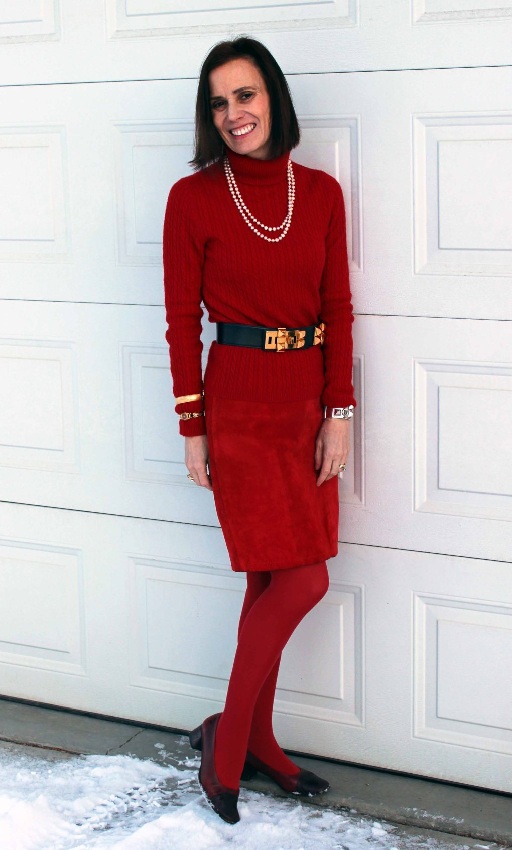 #leatherover40 mature woman wearing a red leather skirt