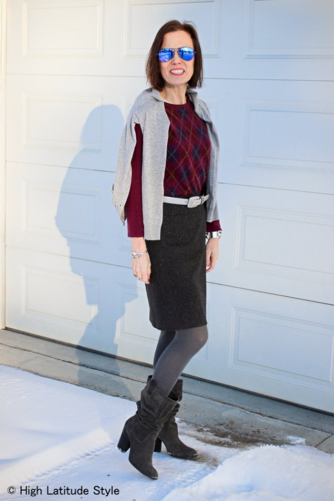 #fashionover40 woman in tweet skirt with sweater and cardigan worn over the shoulders
