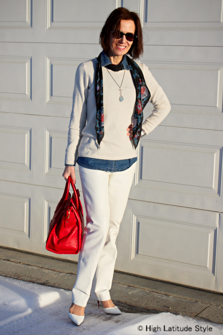 styleover40 layering a denim shirt under sweater accessorized with pearl pendant necklace
