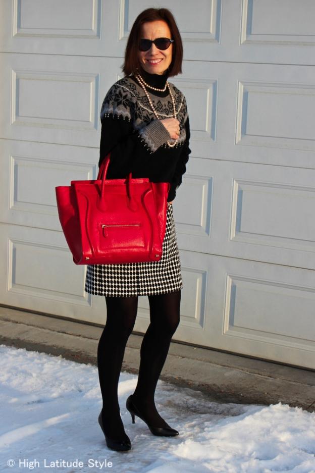 mature women fashion Wearing a sweater over a sheath