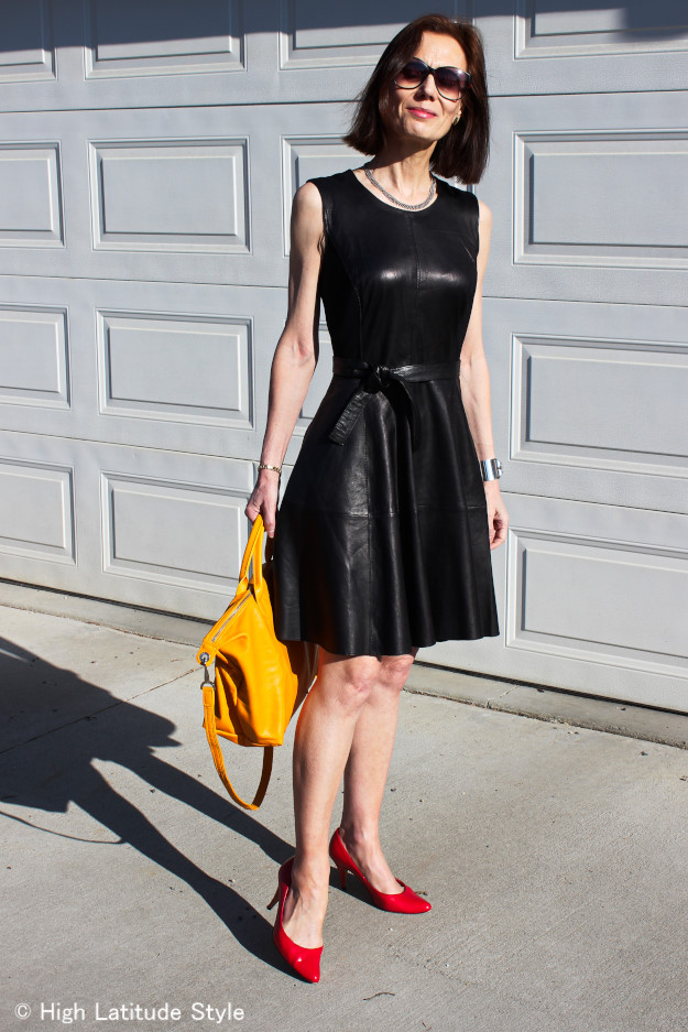 #Fashionover50 woman in fit-and-flare leather dress styled for summer