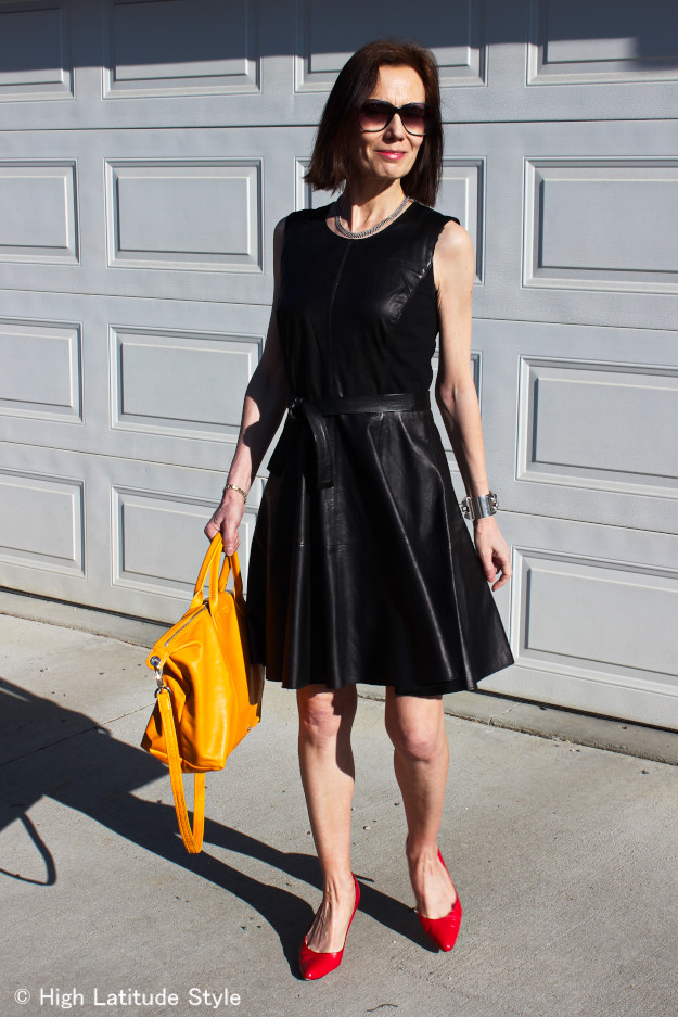 Fit-and-flareleatherdress #pilagebag #redpumps