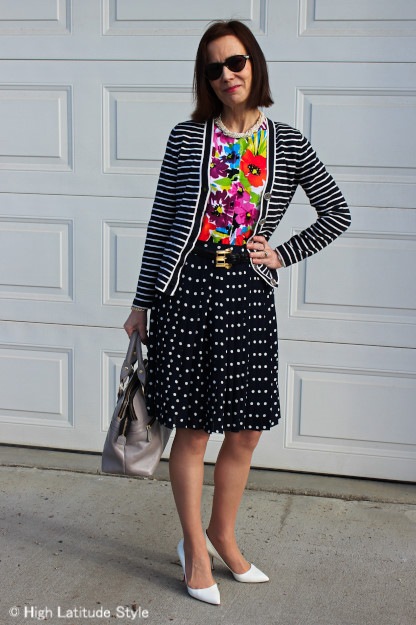 #fashionover40 woman in striped cardigan and floral print top and polka dot skirt