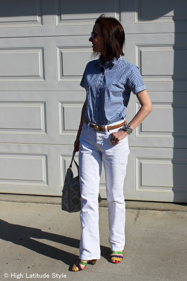 #fashionover40 mature woman wearing a gingham shirt with white jeans