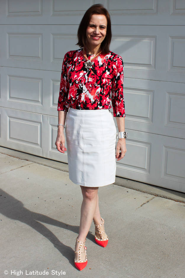 fashion over 40 woman in floral top with leather skirt