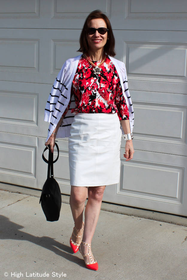 fashion over 50 woman in leather skirt work outfit with cardigan