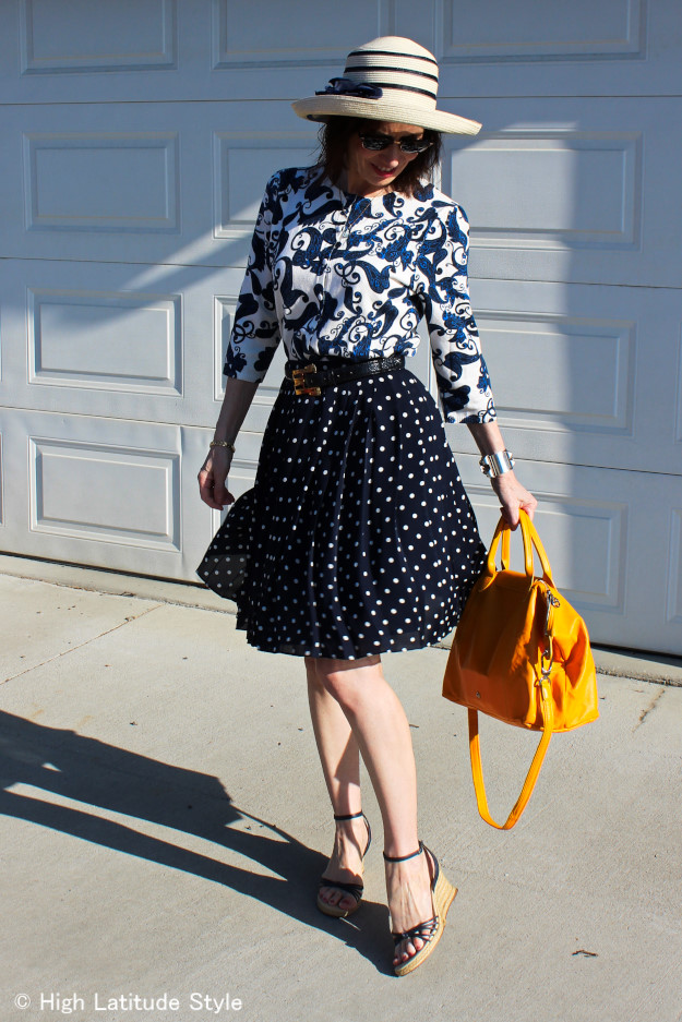 #styleover40 mature woman in cardigan with polka dot skirt at High Latitude Style