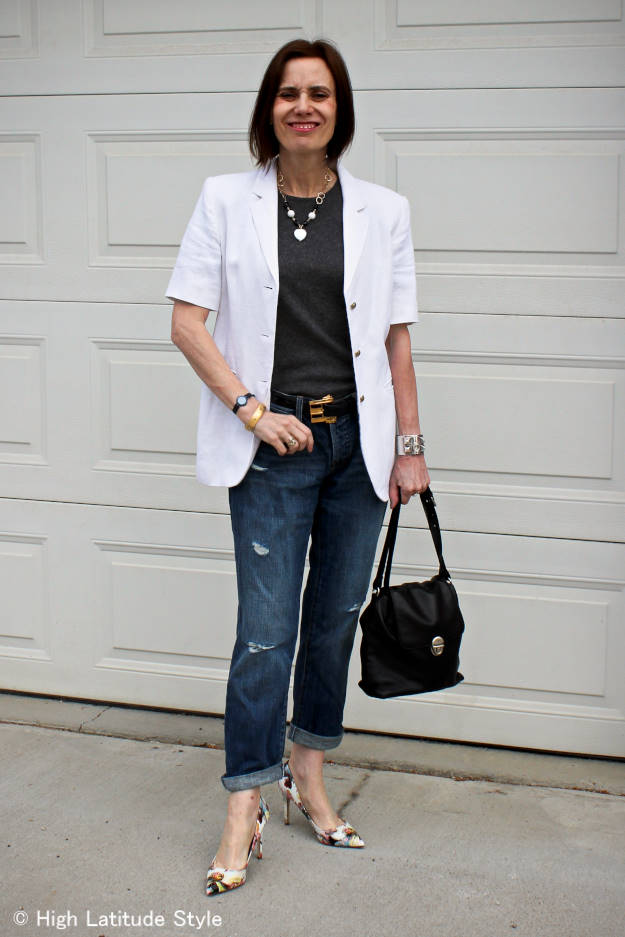 mature woman in polished style with distressed jeans