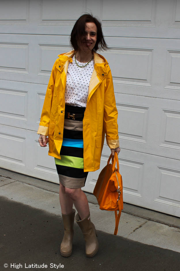 fashionover40 woman wearing a skirt on a rainy day