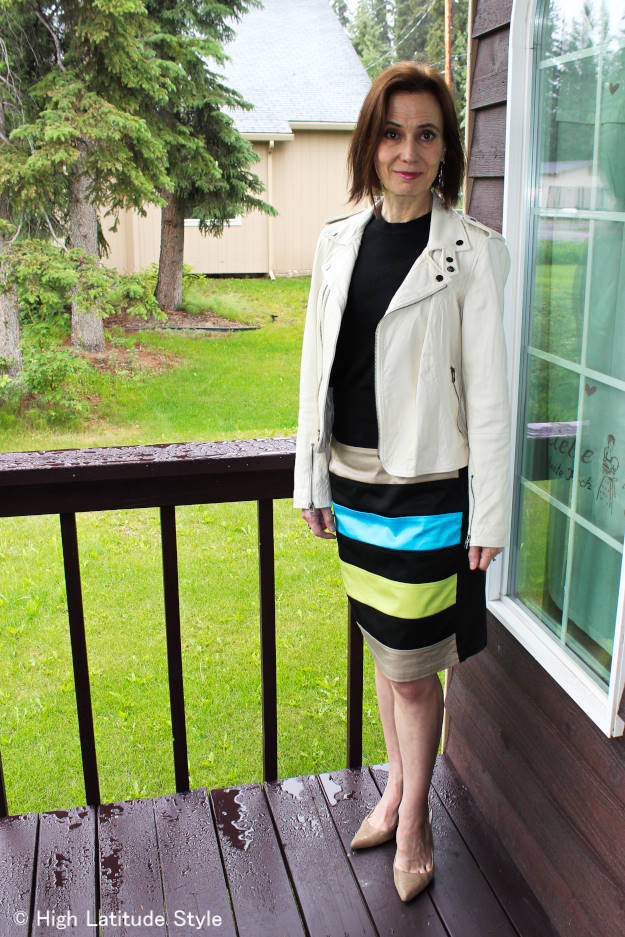 fashion over 40 Woman in white leather motorcycle jacket
