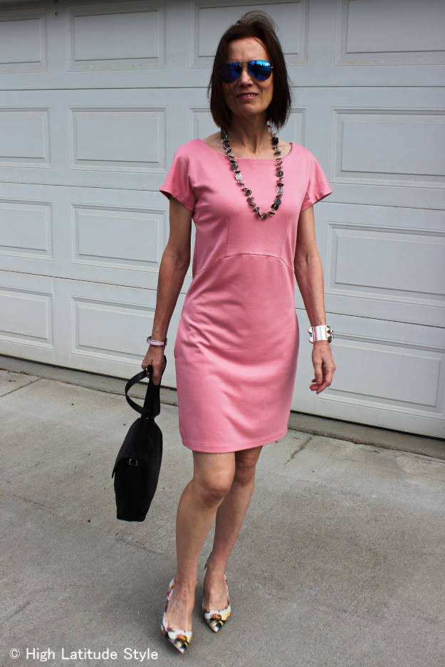 #fashionover50 mature woman in baby pink dress