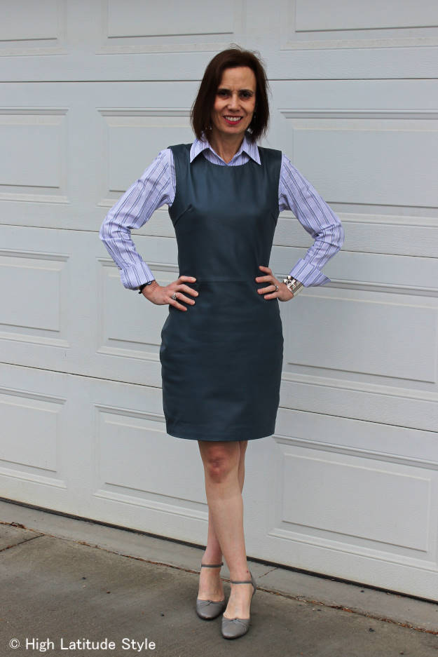 #fashionover40 woman in leather sheath with striped button-down shirt
