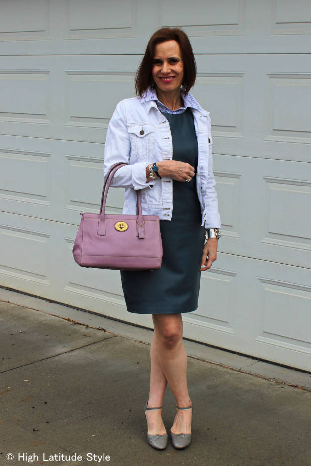 #fashionover50 woman in leather sheath styled for work