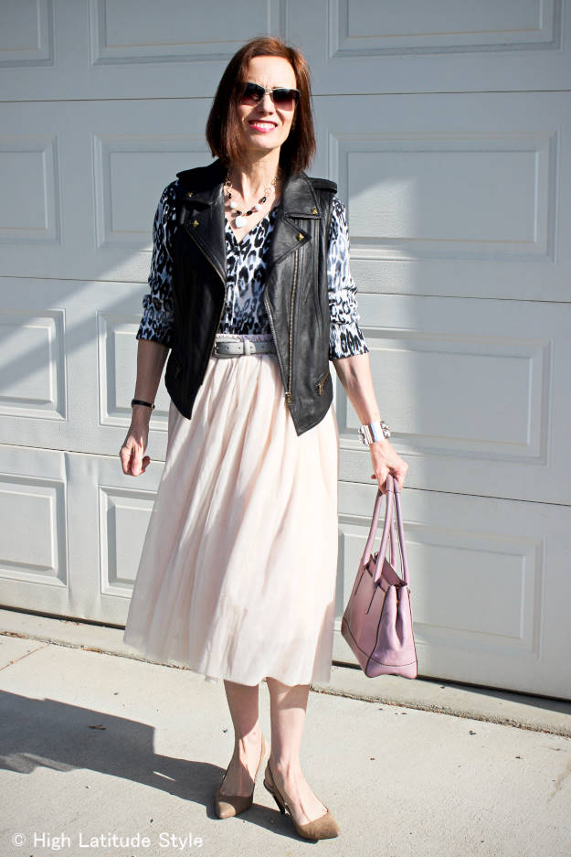 fashion over 40 woman in mesh skirt with motorcycle vest
