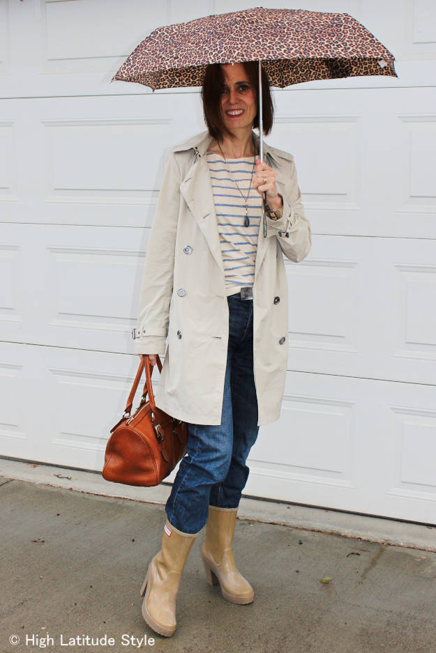 #MarineLayer mature woman in striped T-shirt and trench coat
