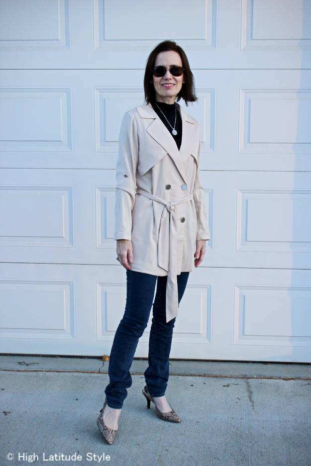 fashionover50 woman in trench coat with skinnies