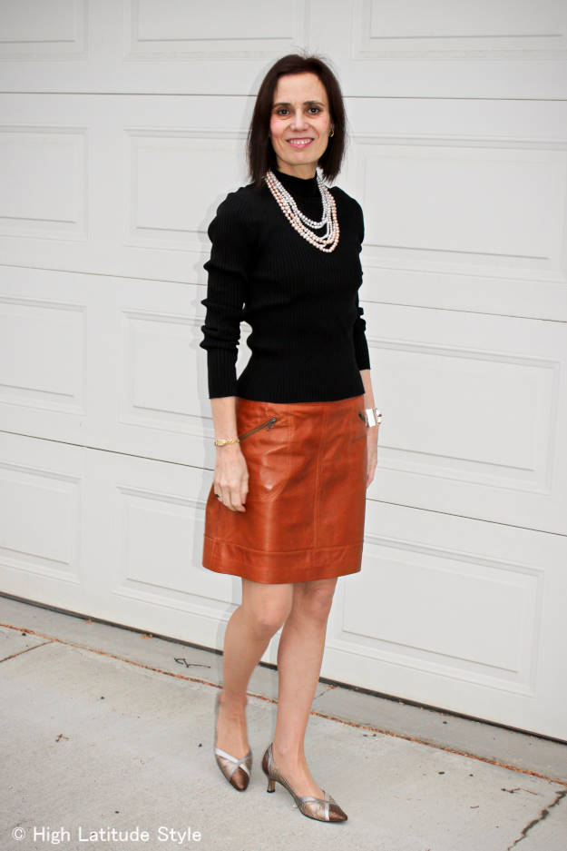 #over50fashion mature woman with A-line leather skirt styled for work