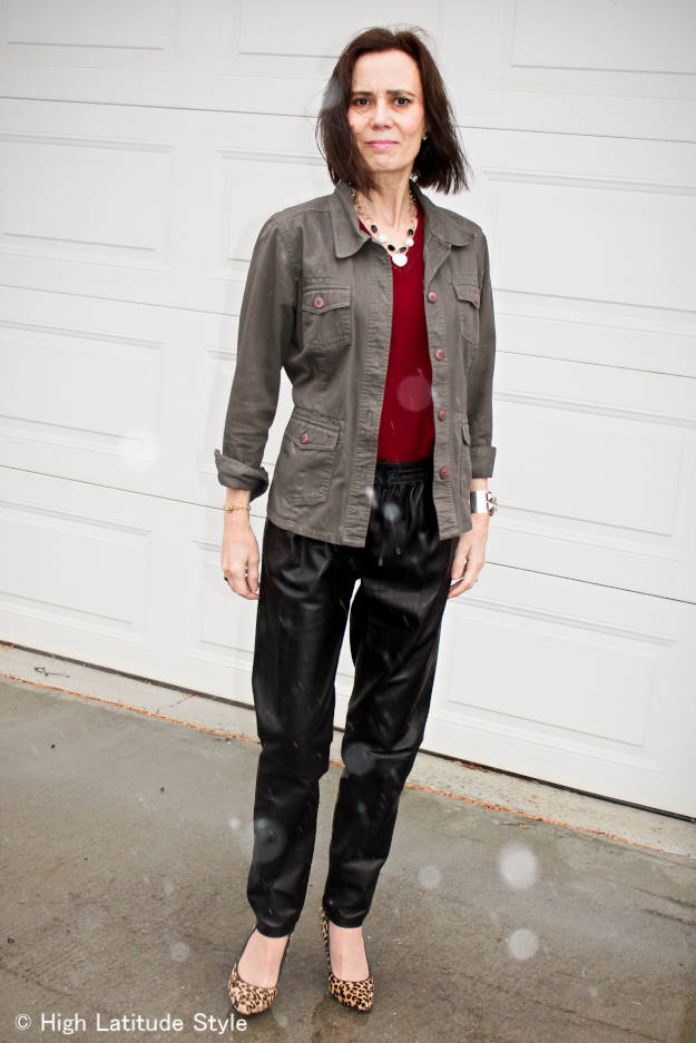 mature woman in weekend style with leather joggers and utility jacket