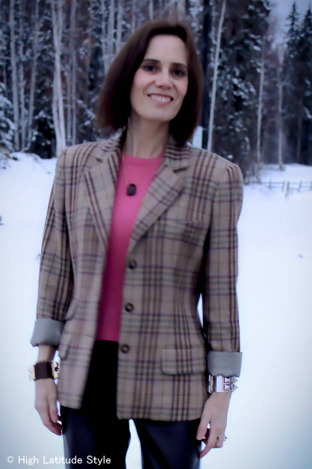 mature lady in pink sweater with chic plaid blazer