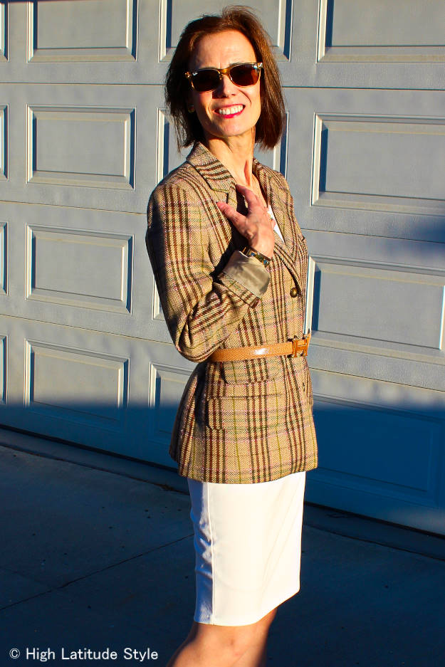 style over 50 woman in plaid blazer with belt and dress