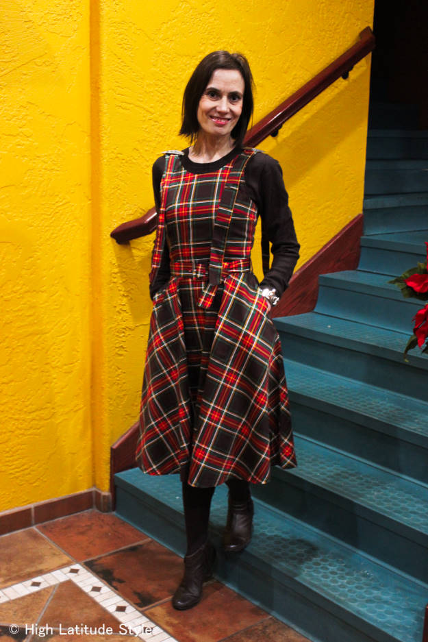 midlife woman looking posh in a plaid fit-and-flare dress