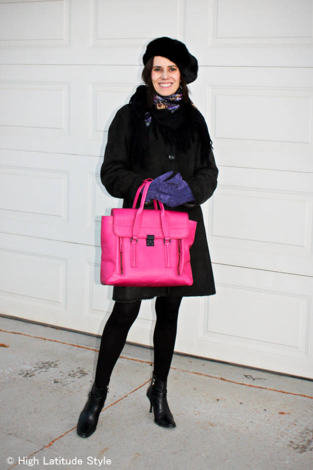 midlife woman  in a fashion forward winter look with pops of color