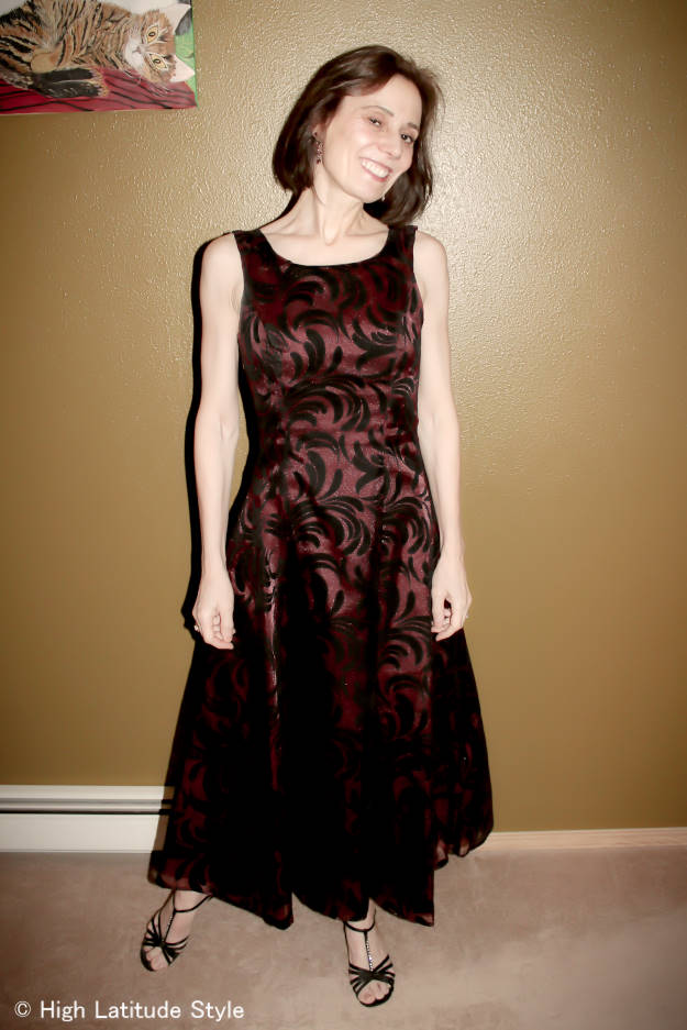 #styleover50 woman in velvet burgundy and black evening gown