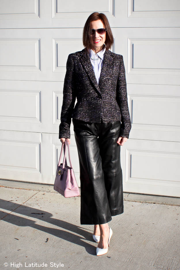 #fashionover40 mature woman in a tweed blazer with leather culottes