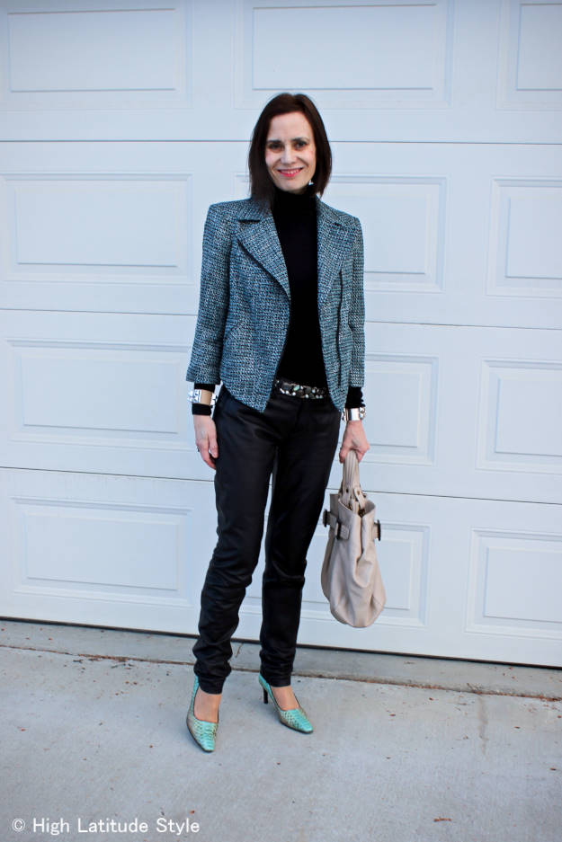 #fashionover50 midlife woman in tweed motorcycle jacket with leather pants