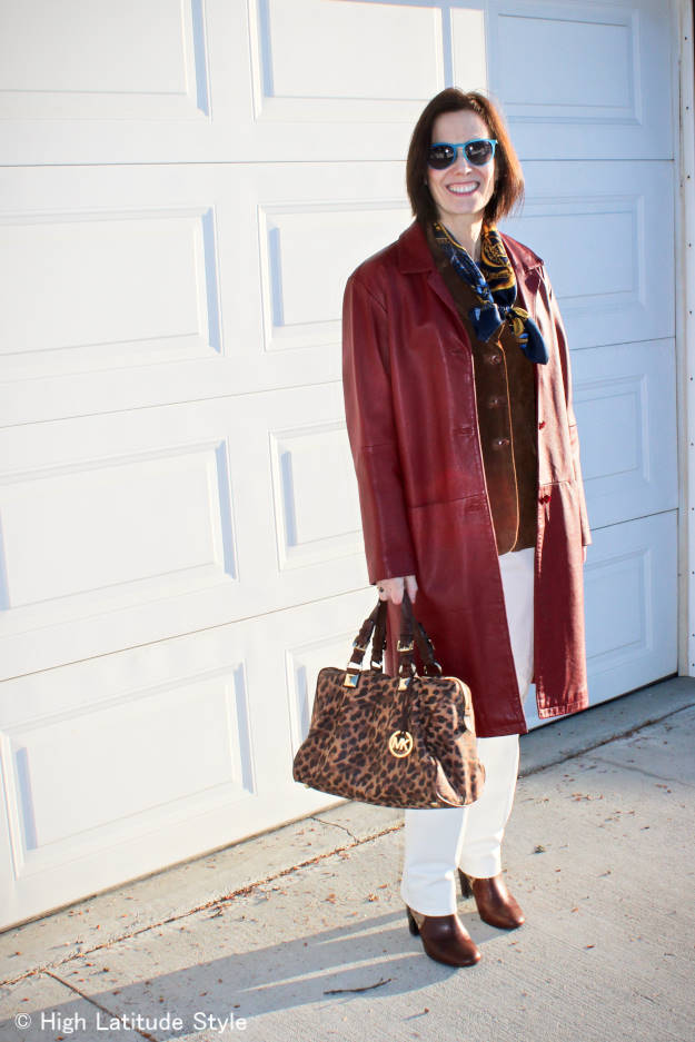 fashion over 50 woman in leather coat over suede jacket and leather pants