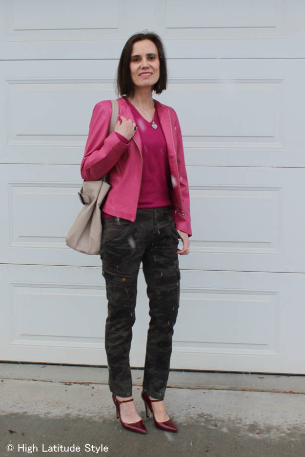 #over40fashion woman wearing camouflage pants and a pink biker jacket