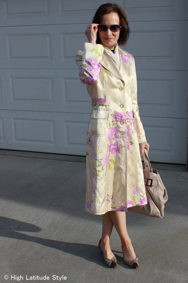 #over50fashion mature woman in floral print sleek coat