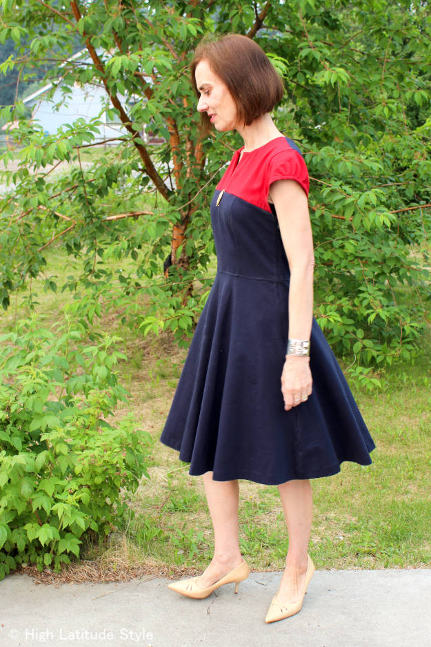 Ageless Style woman in fit-and-flare dress