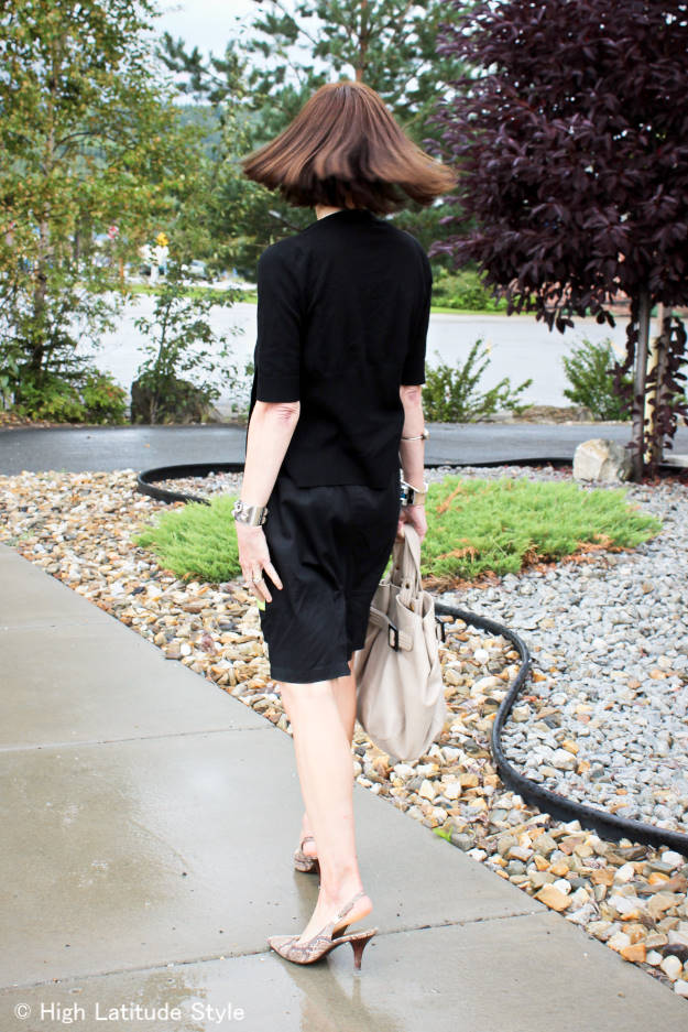 advanced style woman in short sleeve cardigan with skirt