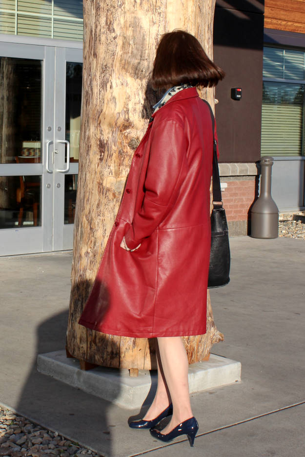 #fashionover50 mature woman in boxy leather coat